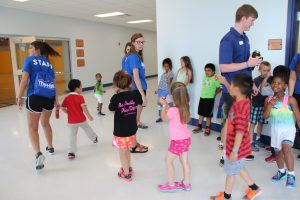 Summer Campers Walking in a Line at The HUB Recreation Center