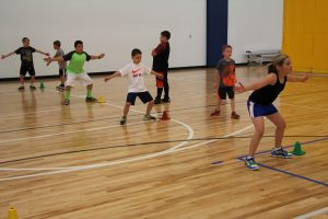 Young Boys and Girls Running Basketball Drills at The HUB Recreation Center