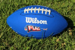 Flag Football in the Grass