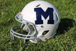 Marion Football Helmet in the Grass
