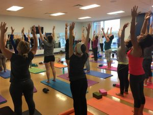 Women Stretching Yoga at The HUB Recreation Center