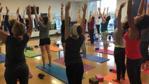 Dozens of Women Stretching Yoga Pose at The HUB Recreation Center