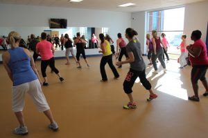 Group of Women Doing Zumba at The HUB Recreation Center