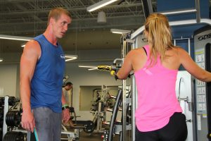 Man Training Young Lady at The HUB Recreation Center