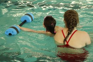 Young Girl and Swim Instructor at The HUB Recreation Center in Marion Illinois