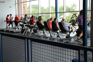 Treadmills and Bikes Full in Front Window of the Fitness Center at The HUB Recreation Center