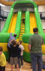Small Boy Going Up Inflatable Slide at The HUB Recreation Center in Marion Illinois