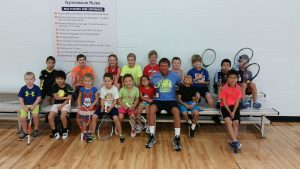 Small kids and tennis instructor The HUB Recreation Center