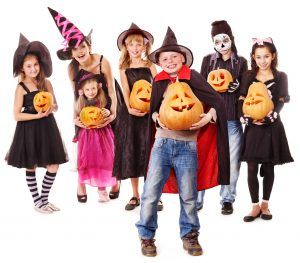 Kids in Halloween Costumes with Pumpkins at The HUB Recreation Center
