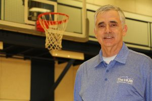 Ray Cagle in front of a basketball hoop at The HUB Recreation Center
