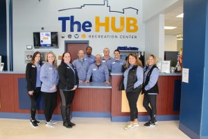 Full-Time Staff in Front of the Counter at The HUB Recreation Center