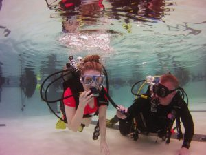 Student and Mermet Springs Dive Leader Scuba Diving in a Pool at The HUB Recreation Center