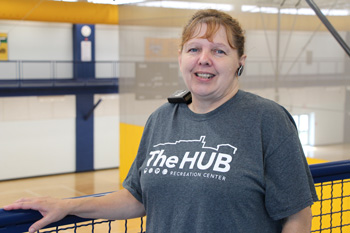 Woman Stands on the Indoor Track at The HUB