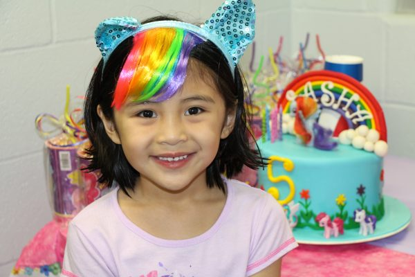 Young Girl Smiling in Front of Her Birthday Cake at The HUB Recreation Center in Marion Illinois