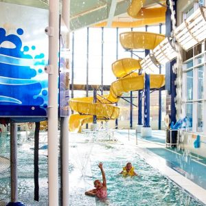 Swimming Boy Waterslide and Lazy River at The HUB Recreation Center in Marion Illinois