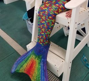 Rainbow Mermaid Fin in a Chair at The HUB Recreation Center