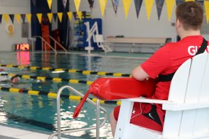 Lifeguard on Duty Watching over Swimmer at The HUB Recreation Center in Marion Illinois