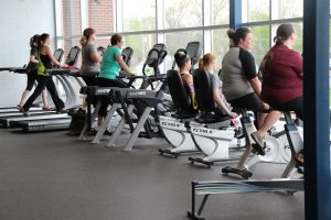 Ladies Using Treadmills and Bikes at The HUB Recreation Center