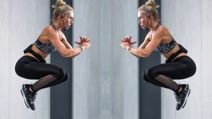 Fit Woman Floating in Squat Position in the Air