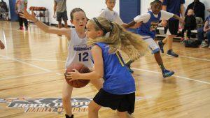 Young Boys and Girls Playing Basketball