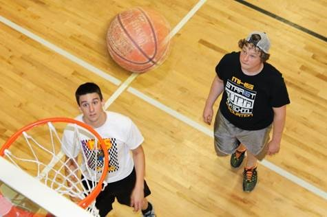 Two young men playing basketball at The HUB in Marion, Illinois